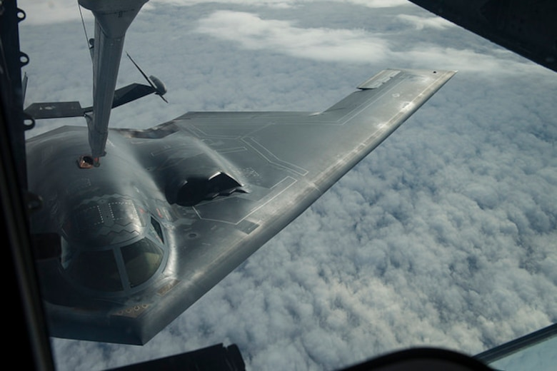 A B-2 Spirit from Whiteman Air Force Base, Mo. receives fuel from a KC-10 Extender from Joint Base McGuire-Dix-Lakehurst, N.J. during a Mobility Exercise held by JB MDL. The Joint Base holds an annual MOBEX in Gulfport, Miss. to practice deploying and operating in a deployed environment.(U.S. Air Force photo by Senior Airman Joshua King)