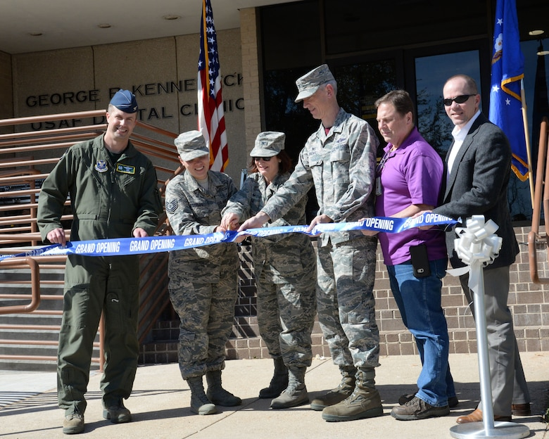 Col. Ty Newman, left, 2 Bomb Wing Commander, joined the 2nd Dental Squadron staff and community partners for a ribbon cutting ceremony at Barksdale Air Force Base, La., March 3,2017. The building is a one story modern facility constructed in 1976. It consists of 40 treatment rooms equipped with modern dental units and a Central Instrument Sterilization Processing Center. The renovation took two years and 28 days., included a 1,763 square-foot addition, a gain of three treatment rooms, including new dental chairs and cabinetry, and a new lobby.The Dental Squadron has four flights with 65 authorized military and civilian personnel. It provides dental care to over 5, 300 active duty Airmen. Barksdale's 2nd DS clinic is named after Major General George R. Kennebeck, the first Assistant Surgeon General for Dental Services. (U.S. Air Force photo by Nevardo Cayemitte/Released)