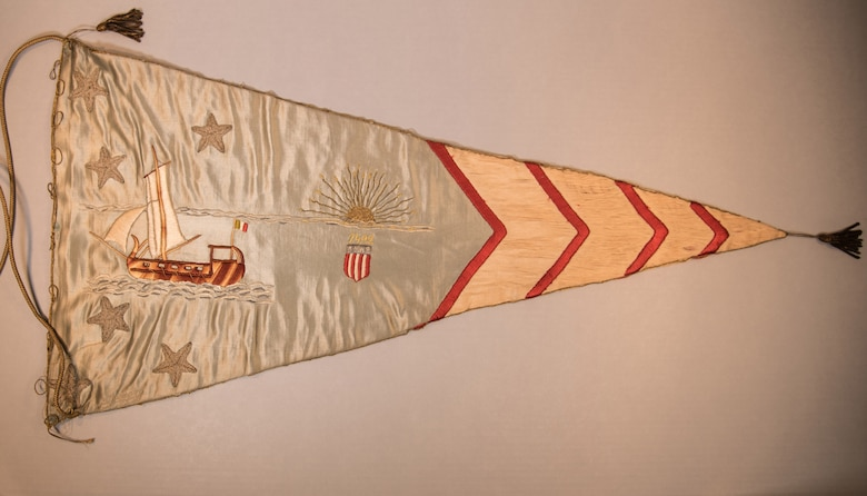 On April 12, 1919, a flag presentation ceremony was held in Paris in honor of the Air Service, A.E.F. Hundreds of banners, hand made by French women, were presented to representatives of the various U.S. squadrons that had served in France during WWI. Five of theses pennants are on display in the museum's Early Years Gallery. This item is currently in storage. (U.S. Air Force photo by Ken LaRock)