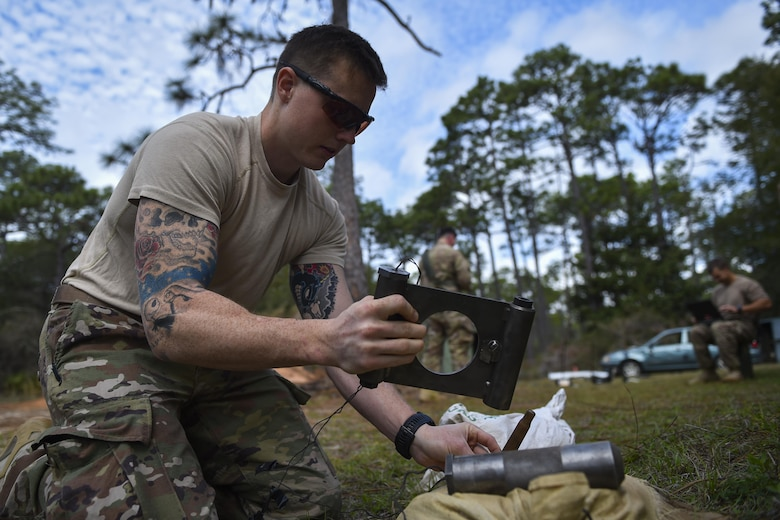 Airman 1st Class Lawrence Gress, an explosive ordinance disposal journeyman with the 1st Special Operations Civil Engineer Squadron, wires an MK1 rocket wrench during EOD tool training at Hurlburt Field, Fla., Mar. 6, 2017. EOD specialists conduct tool training to remain familiar with equipment and ensure operational readiness. (U.S. Air Force photo by Airman 1st Class Joseph Pick)