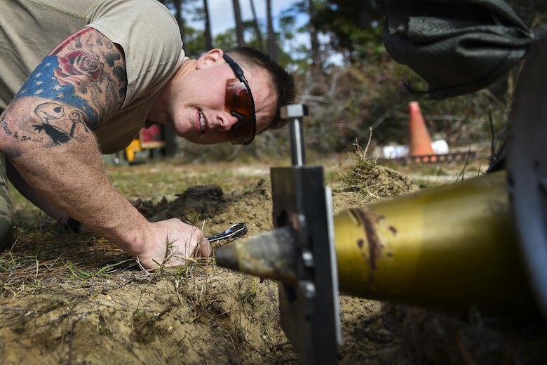 Airman 1st Class Lawrence Gress, an explosive ordinance disposal journeyman with the 1st Special Operations Civil Engineer Squadron, checks the jaw assembly of an MK1 rocket wrench during EOD tool training at Hurlburt Field, Fla., Mar. 6, 2017. If the rocket wrench is not straight, it may not properly remove the fuse and could cause damage to the tool. (U.S. Air Force photo by Airman 1st Class Joseph Pick)