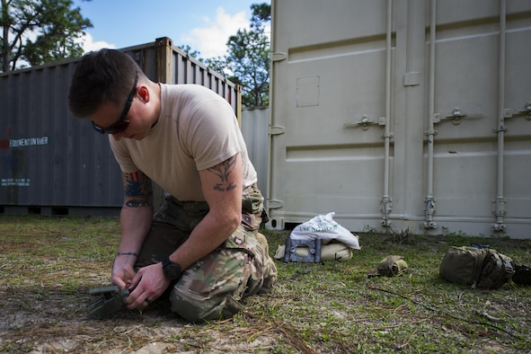 Airman 1st Class Lawrence Gress, an explosive ordinance disposal journeyman with the 1st Special Operations Civil Engineer Squadron, tests the .50 caliber blank rounds of an MK1 rocket wrench during EOD tool training at Hurlburt Field, Fla., Mar. 6, 2017. The electrical detonation of the two .50-caliber blank rounds causes the rocket wrench to spin rapidly, removing the fuse attached to the ordnance in the process. (U.S. Air Force photo by Airman 1st Class Joseph Pick)