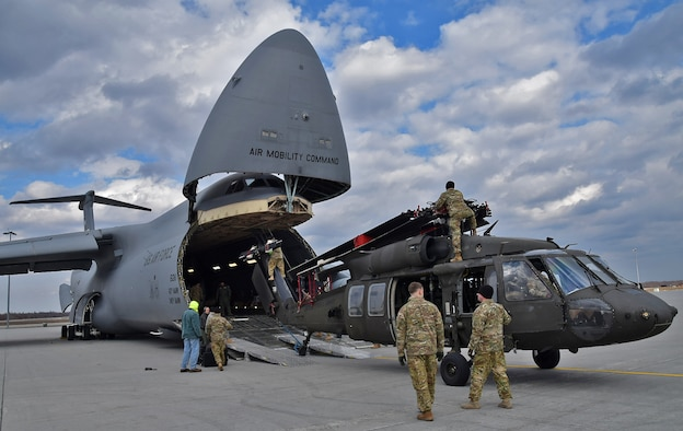 U.S. Army 10th Combat Aviation Brigade Soldiers prepare to load a UH-60 Blackhawk onto an Air Mobility Command C-5M Super Galaxy flown by the Air Force Reserve Command's 68th Airlift Squadron Feb. 27, 2017 on Ft. Drum, N.Y. in support of Operation Atlantic Resolve. (U.S. Air Force photo/Tech. Sgt. Carlos J. Trevino)