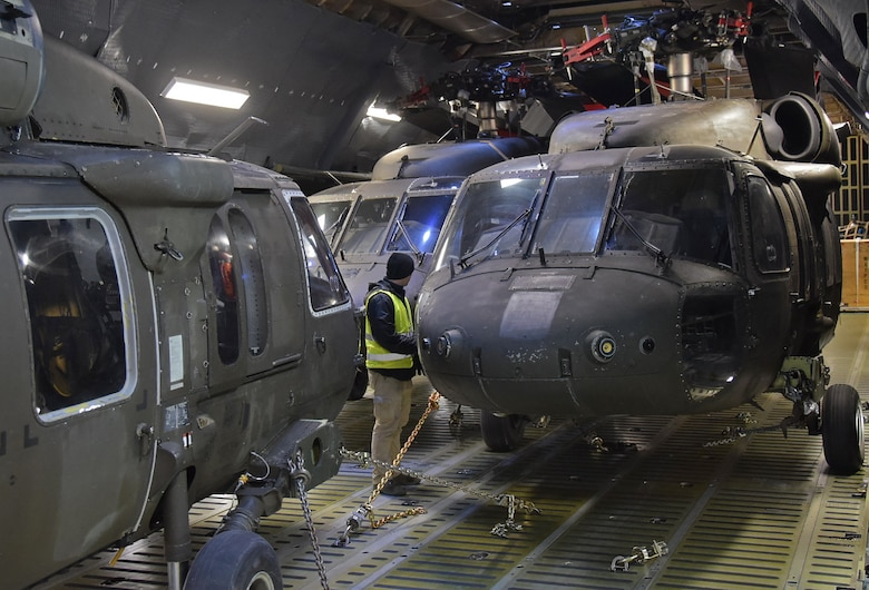 Three U.S. Army UH-60 Blackhawk helicopters belonging to the 10th Combat Aviation Brigade from Ft. Drum, N.Y. are secured and readied for transport on an Air Mobility Command C-5M Super Galaxy on Feb., 27, 2017.  The helicopters and 22 Army Soldiers were flown by Air Force Reserve Command's 68th Airlift Squadron to Riga, Latvia as part of Operation Atlantic Resolve. (U.S. Air Force photo/Tech. Sgt. Carlos J. Trevino)