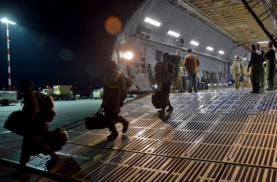 U.S. Army Soldiers belonging to the 10th Combat Aviation Brigade from Ft. Drum, N.Y. walk off the ramp of a C-5M Super Galaxy at  Riga, Latvia, to begin their nine-month deployment in support of Operation Atlantic Resolve on Mar. 4, 2017. (U.S. Air Force photo/Tech. Sgt. Carlos J. Trevino)