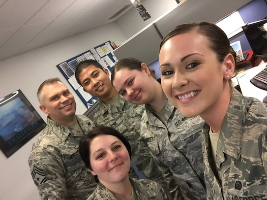 Chief Master Sgt. Tommy Mazzone, Air Force District of Washington Command Chief, visits with Airmen from the 11th Wing Force Support Squadron Management Section Feb. 24, 2017.