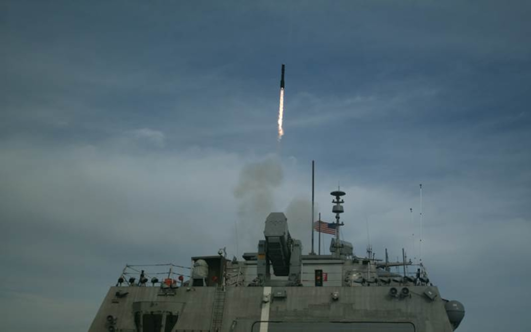 ATLANTIC OCEAN—The first of three Longbow Hellfire Missiles is fired from Littoral Combat Ship USS Detroit (LCS 7) as part of a ripple shot completed during structural test firing (STF) on Feb. 28, 2017, off the coast of Norfolk, Virginia. The STF is part of the developmental test program for the Surface to Surface Missile Module.