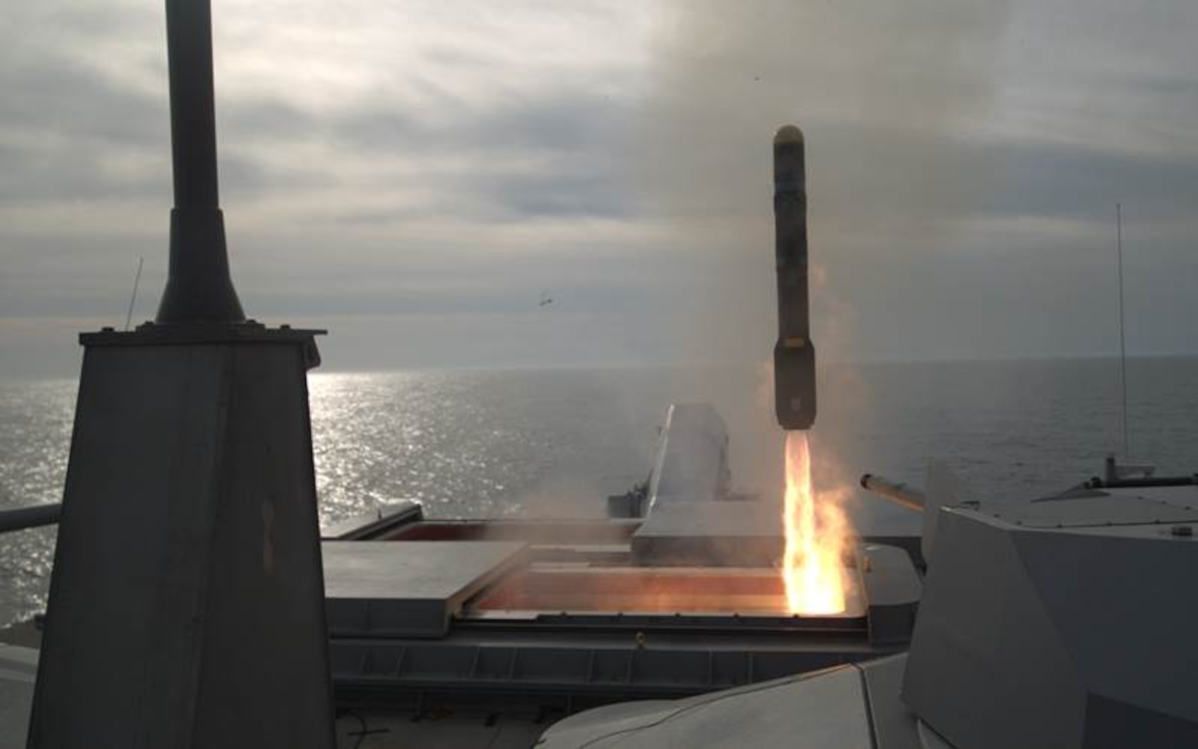 ATLANTIC OCEAN—A Longbow Hellfire Missile is fired from Littoral Combat Ship USS Detroit (LCS 7) on Feb. 28 as part of a structural test firing of the Surface to Surface Missile Module (SSMM). The test marked the first vertical missile launched from an LCS and the first launch of a missile from the SSMM from an LCS.