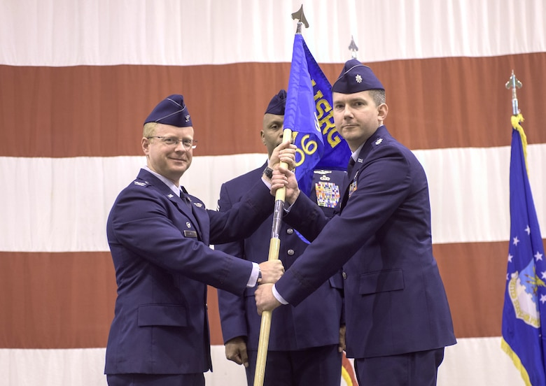 Col. Matthew Atkins, 361st Intelligence, Surveillance and Reconnaissance Group Commander, Hurlburt Field, Florida, and Lt. Col. Stephen McFadden, 306th Intelligence Squadron commander, participate in an assumption of command ceremony hosted by the 137th Special Operations Wing, March 6, 2017, at Will Rogers Air National Guard Base, Oklahoma City. Lt. Col. Stephen McFadden took command of the 306th Intelligence Squadron, formerly located at Beale Air Force Base, California, upon its activation at WRANGB. (U.S. Air National Guard photo by Staff Sgt. Kasey Phipps)