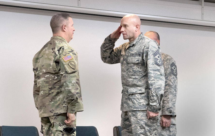 Chief Master Sgt. James Dixon, incoming state Command Chief Master Sgt., salutes Maj. Gen. James A. Hoyer, The Adjutant General of the West Virginia National Guard, signifying his assumption of responsibility for the enlisted force of the WVNG during a change of responsibility ceremony held Feb. 4, 2017 at McLaughlin Air National Guard Base, Charleston, W.Va. Dixon replaced outgoing state Command Chief Master Sgt. Fred Turner, Jr. (U.S. Air National Guard photo by Capt. Holli Nelson)