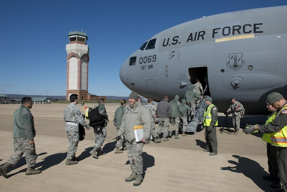 Airmen from the 167th Airlift Wing board a C-17 Globemaster III aircraft while members of the wing inspection team observe during a mobility exercise at the Martinsburg, W.Va. air base March 4. The exercise was conducted, in part, to prepare airmen for upcoming deployments.
