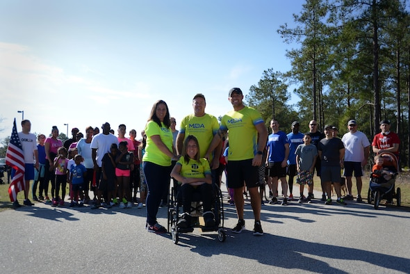U.S. Air Force Senior Airman Michael Hall, 20th Aerospace Medicine Squadron flight and operation medical technician, center right, stands with his family and fellow runners before a 5K at Shaw Air Force Base, S.C., Feb. 25, 2017. The 20th Medical Group held the race to raise awareness for muscular dystrophy and to help Hall reach his goal of $10,000 in donations for the Muscular Dystrophy Association. (U.S. Air Force photo by Airman 1st Class Kelsey Tucker)