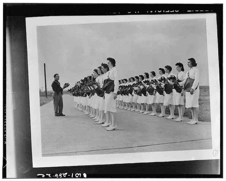 The Women's Army Auxiliary Corps first 156 members arrived at Scott Field in March 1943, and they worked in the radio school, offices, motor pool, hangar, control tower, and the hospital, such as these pictured nurses. By that August, these service women were taking the oath of the Women's Army Corps, which earned them regular Army ratings, grades, privileges, and benefits.