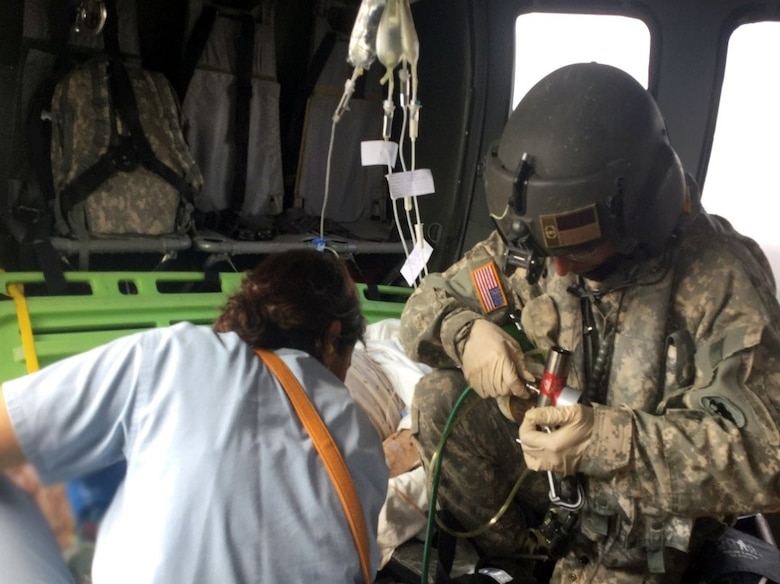 Members of the 1-228 AVN's MEDEVAC Company transport a critically ill U.S. military retiree from a hospital in Siguatepeque to Tegucigalpa for further care Feb 18.  The MEDEVAC Company is assigned to Joint Task Force – Bravo at Soto Cano Air Base in Honduras.  The company trains daily for critical missions such as these and on this day were able to put all their training and skills into action for a real world mission that helped save a life. (Courtesy photo)