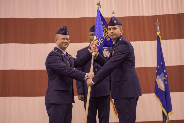Col. Matthew Atkins, 361st Intelligence, Surveillance and Reconnaissance Group Commander, Hurlburt Field, Fla., and Lt. Col. Stephen McFadden, 306th Intelligence Squadron commander, participate in an assumption of command ceremony hosted by the 137th Special Operations Wing, March 6, 2017, at Will Rogers Air National Guard Base, Oklahoma City. Lt. Col. Stephen McFadden took command of the 306th Intelligence Squadron, formerly located at Beale Air Force Base, Calif., upon its activation at WRANGB. (U.S. Air National Guard photo by Staff Sgt. Kasey Phipps)