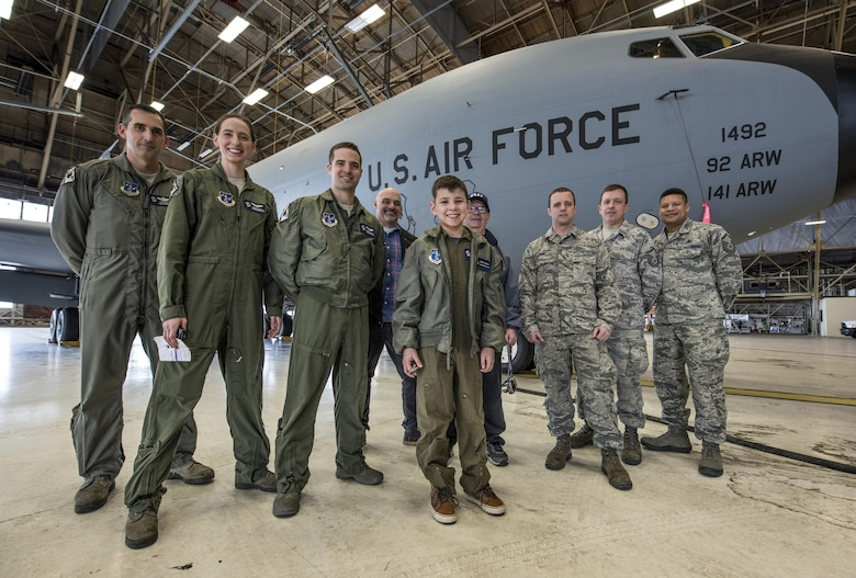 "Members of the 141st Air Refueling Wing pose with ""Pilot for a Day"" candidate Gabe Tesch during a tour of a KC-135 Stratotanker static display Mar. 1, 2017, at Fairchild Air Force Base, Washington. Gabe spent the day visiting several work centers throughout the base receiving hands on instruction and briefings on what it takes to be a KC-135 pilot. The ""Pilot for a Day"" program provides disadvantaged or seriously ill children a chance to spend the day with members of the Washington Air National Guard training as an honorary pilot. (U.S. Air Force photo by Master Sgt. Michael Stewart/Released)"