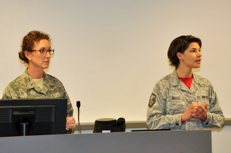 Senior Master Sgt. Anne Williams, 114th Munitions production superintendent, and Master Sgt. Casey Bullies, 114th Operations Group administrative assistant, speak during the inaugural Top 3 meeting at Joe Foss Field, S.D., March 5, 2017. Sgt. Williams and Sgt. Bullis were instrumental in getting the Top 3 going at the 114th Fighter Wing. (U.S. Air National Guard photo by Master Sgt. Christopher Stewart/Released)