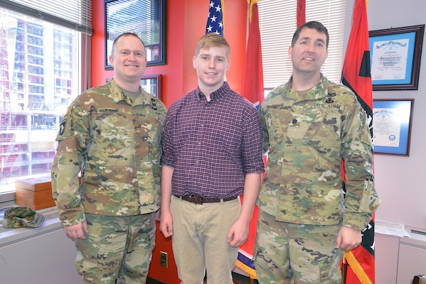 Maj. Christopher Burkhart, Nashville District deputy commander (right) Charles Nissen a sophomore student from Montgomery Bell Academy (center) and Lt. Col. Stephen L. Murphy, Nashville District commander, pose for a photo after Nissen receives a brief on the district.  Nissen, a sophomore student from Montgomery Bell Academy spent the day shadowing U. S. Army Corps of Engineers Nashville District engineers.