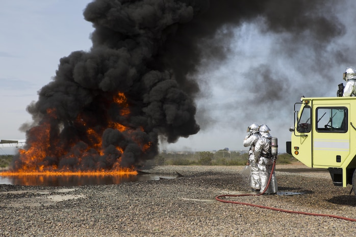 Aircraft Rescue and Firefighting Marines with Headquarters and Headquarters Squadron (HHS) and Marine Wing Support Squadron (MWSS) 473 conduct a controlled burn exercise at the ARFF training pit at Marine Corps Air Station Miramar, Calif., March 4. Marines with ARFF are responsible for any fire or hazardous material mishap that involves an aircraft. (U.S. Marine Corps photo by Lance Cpl. Liah Kitchen/Released)