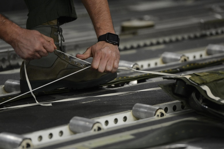 Staff Sgt. Justin Baez, 7th Airlift Squadron loadmaster, prepares a drogue chute aboard a McChord C-17 Globemaster III prior to a heavy equipment drop March 3, 2017, at Pope Army Airfield, N.C. The equipment drop was part of a joint readiness exercise, also known as a Battalion Mass Tac exercise, with Airmen and Army Airborne members. (U.S. Air Force photo by Master Sgt. Sean Tobin)
