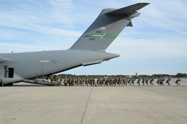 U.S. Army paratroopers from the 82nd Airborne Division board a McChord C-17 Globemaster III prior to a personnel drop March 3, 2017, at Pope Army Airfield, N.C. The exercise took place to provide hands-on training to Air Mobility Command aircrews while supporting Soldiers from the 82nd Airborne Division stationed at Fort Bragg, N.C. (U.S. Air Force photo by Master Sgt. Sean Tobin)