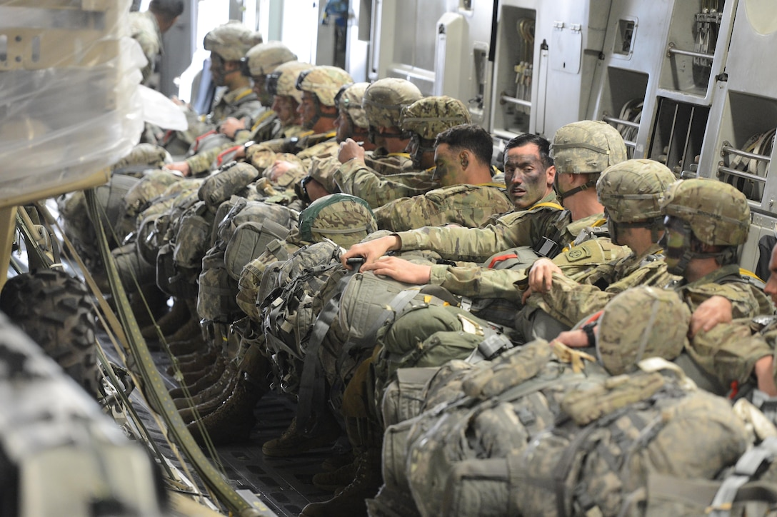 U.S. Army paratroopers from the 82nd Airborne Division sit aboard a McChord C-17 Globemaster III aircraft prior to a static line jump in support of a joint readiness exercise March 3, 2017, at Pope Army Airfield, N.C. During the exercise, U.S. Air Force aircraft dropped more than 2,400 Army personnel. (U.S. Air Force photo by Master Sgt. Sean Tobin)