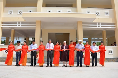 On March 1, Susan Sutton (sixth from right), deputy chief of mission at the U.S. Embassy in Hanoi, presented the Ninh Thuan Province disaster management coordination center to the people of Vietnam during a ceremony. The Alaska District managed the construction of the two-story facility, which is one of 11 similar projects completed along Vietnam's coastal provinces that are hit by cyclone and flooding events. In addition to the building, a communications system will also support efforts to prevent and minimize loss of life and property during emergencies. The total cost of the building is about $693,400 and required 11 months to complete.