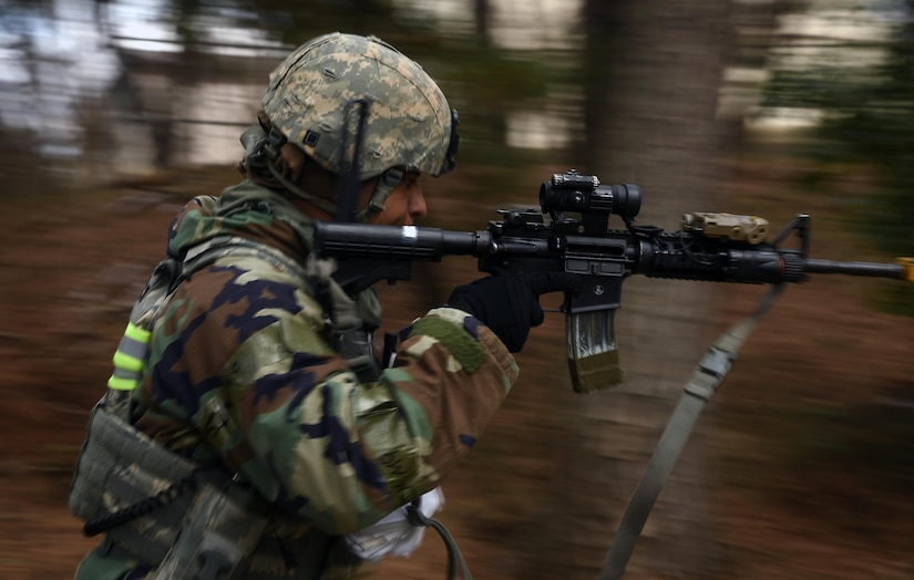 Tech. Sgt. Jeffery Self, 8th Security Forces Squadron team member, advances toward opposing forces during a training scenario at Kunsan Air Base, Republic of Korea, March 7, 2017. Self used the advancing technique as part of exercise Beverly Pack 17-2, a no-notice training exercise used to improve responses to base threats. (U.S. Air Force photo by Tech. Sgt. Jeff Andrejcik/Released)