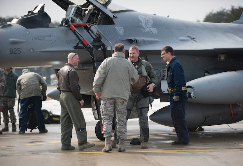 Chief Master Sgt. Charles Frizzell, 35th Fighter Wing command chief, shakes Lt. Col. Mark Heusinkveld's, 14th Fighter Squadron commander, hand at Misawa Air Base, Japan, March 4, 2017. Heusinkveld returned from exercise COPE NORTH 17, which originated here in 1978 and serves as a keystone event promoting stability and security throughout the Indo-Asia-Pacific region by enabling regional forces to hone vital readiness skills critical to maintaining regional stability. (U.S. Air Force photo by Senior Airman Brittany A. Chase)