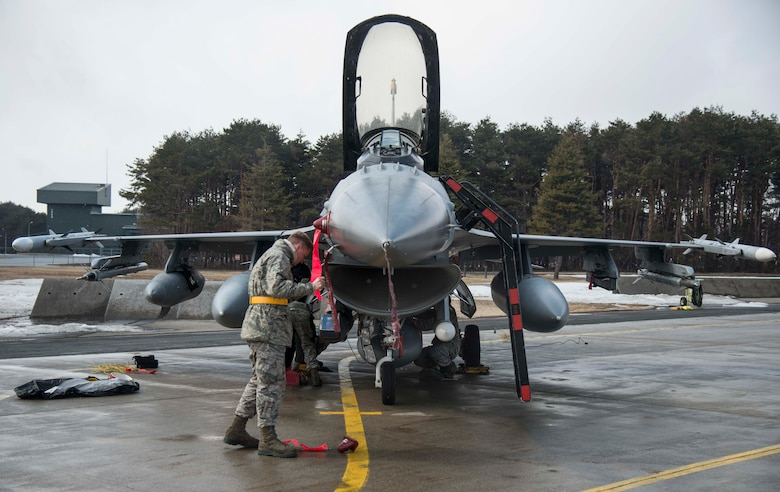 Airman 1st Class Shelby Flowers, 14th Aircraft Maintenance Unit avionics technician, places a cover on an F-16 Fighting Falcon at Misawa Air Base, Japan, March 4, 2017. Aircraft returned from COPE NORTH 17, an annual exercise serving as a keystone event promoting stability and security throughout the Indo-Asia-Pacific region. COPE NORTH dates back to 1978 when it took place here. (U.S. Air Force photo by Senior Airman Brittany A. Chase)