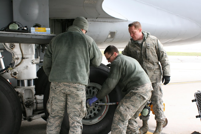 Tech. Sgt. Austin Naylor, Tech. Sgt. Quinton Harward, and Tech.Sgt. Zachariah Harvey, with the 151st Maintenance Group, conduct a tire and brake change on a KC-135R Stratotanker on the flight line at Roland R. Wright Air National Guard Base Feb. 22, 2017, due to a cracked brake heat shield. The entire process takes three to four hours to complete. (U.S. Air National Guard photo by Maj. Jennifer Eaton)