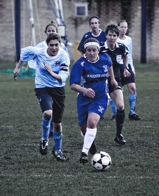 Then-Lt. Roni Yadlin, right, a 2009 graduate of the U.S. Air Force Academy, played for University of Oxford during the school's 2010 season. Seen here, the 2009 Holaday Scholar dribbles the ball upfield in a game against Cambridge in February, 2010. (U.S. Air Force photo).