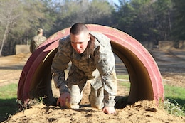 3rd Medical Command Deployment Support 2017 Noncommissioned Officer Best Warrior, Corporal Carlo DelDonno a combat medic from the 804th Medical Brigade in Devens Reserve Forces Training Area, Massachusetts negotiates an obstacle at the joint division Best Warrior Competition in Fort Benning, Georgia.