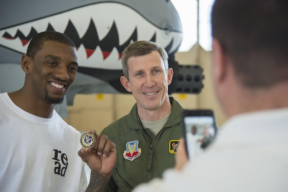 Malcolm Mitchell, left, New England Patriots' wide receiver and Super Bowl LI Champion, and Col. Thomas Kunkel, 23d Wing commander, pose for a photo during his visit March 7, 2017, at Moody Air Force Base, Ga. Mitchell, a Valdosta native, got a glimpse of a typical day in the life of Moody Airmen. Mitchell also spent time with Airmen and signed autographs for local Patriots' fans during his visit. (U.S. Air Force photo by Senior Airman Ceaira Young)