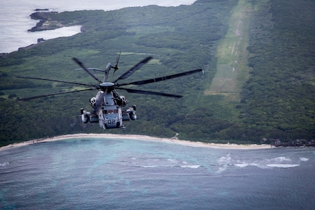Two CH-53E helicopters from SPMAGTF-SC make the flight from Honduras to Haiti as part of the Hurricane Matthew response bypassing a lonely island on the otherwise empty route over the Caribbean Sea, October 4, 2016. The helicopters, crew and maintainers, along with other SPMAGTF-SC Marines, supported humanitarian assistance operations in Haiti for two weeks until follow-on forces arrived. A detachment from Marine Heavy Helicopter Squadron 772, Marine Aircraft Group 49, 4th Marine Aircraft Wing, formed the task force's aviation element. (U.S. Marine Corps photo by SSgt Derek Torrellas)