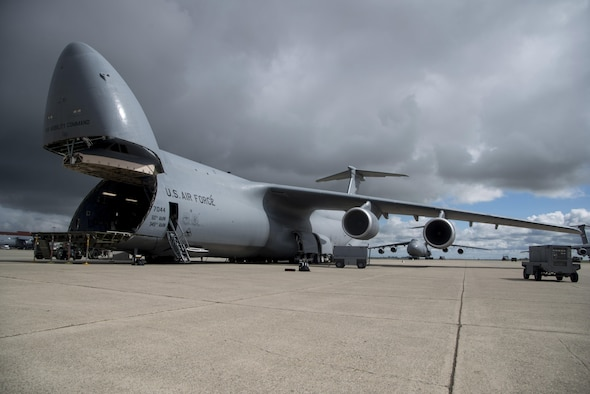 A C-5M Super Galaxy, assigned to the 22nd Airlift Squadron at Travis Air Force Base, California, sits on the ramp prior to a flight to Yokota Air Base, Japan for what's known as a PAC Channel mission March 4, 2017. Since the C-5M upgrade, the aircraft is able to fly direct to Yokota AB without the need to be refueled or make a stop in Hawaii or Alaska. (U.S. Air Force photo/Staff Sgt. Nicole Leidhom)