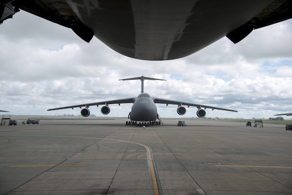 A C-5M Super Galaxy, assigned to the 22nd Airlift Squadron at Travis Air Force Base, California, sits on the ramp prior at Travis AFB, March 4, 2017. Since the C-5M upgrade, the aircraft is able to fly direct to Yokota AB without the need to be refueled or make a stop in Hawaii or Alaska. (U.S. Air Force photo/Staff Sgt. Nicole Leidhom)