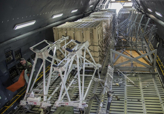 Staff Sgt. Matthew Larson, 22nd Aiirlift Squadron, secures cargo on a C-5M Super Galaxy prior to a flight to Yokota Air Base Japan, March 4, 2017. Larson and his team of loadmasters secured approximately 70,000 pounds of cargo along with seven passengers flying Space-Avaliable travel. (U.S. Air Force photo/Staff Sgt. Nicole Leidholm)