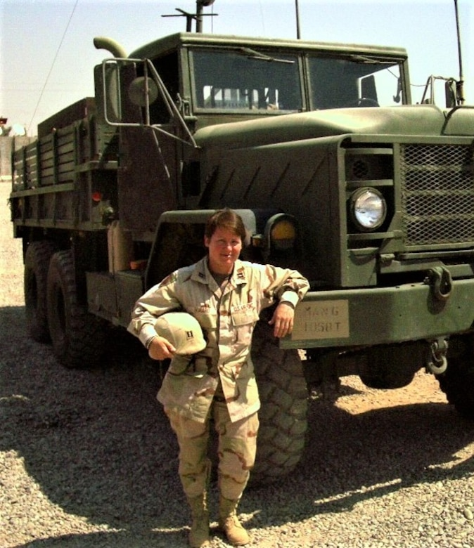 Former Air Force Capt. Annette Martiny poses alongside an M923 5-ton series cargo truck at an undisclosed location in Iraq, Sept. 3, 2004. Commissioned as an officer in 1999, Martiny deployed three times as a logistics plans officer in her 22-year Air Force career. (Courtesy photo)