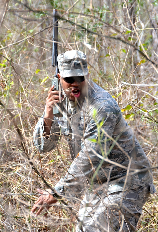 Second Lieutenant Steven Sumpter, 729th Air Control Squadron, Hill Air Force Base, Utah, radios in coordinates during a land navigation exercise provided by the 5th Combat Communications Group on Robins Air Force Base, Ga., March 2, 2017. The 5th CCG provides a two-week course for a maximum of 34 students and cover a variety of topics such as land navigation, improvised explosive device detection, and much more. (U.S. Air Force photo by Tech. Sgt. Kelly Goonan/released)