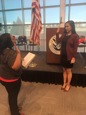 "U.S. Air Force Airman 1st Class Alicia ""Alice"" Contreras, right, 7th Bomb Wing paralegal, recites the oath of citizenship at the department of citizenship and immigration services in Dallas, Texas, Feb. 7, 2017. After almost two years since joining the U.S. Air Force, Contreras was finally able to achieve one of her biggest goals: obtaining American citizenship. (Courtesy photo)"