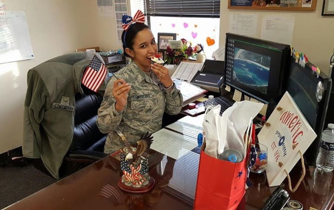 "U.S. Air Force Airman 1st Class Alicia ""Alice"" Contreras, 7th Bomb Wing paralegal gained U.S. citizenship Feb. 7, 2017. When she returned to work, Contreras found that her coworkers had decorated her desk with ""Americana"" decorations to celebrate her accomplishment and dedication to earning it. (Courtesy photo)"