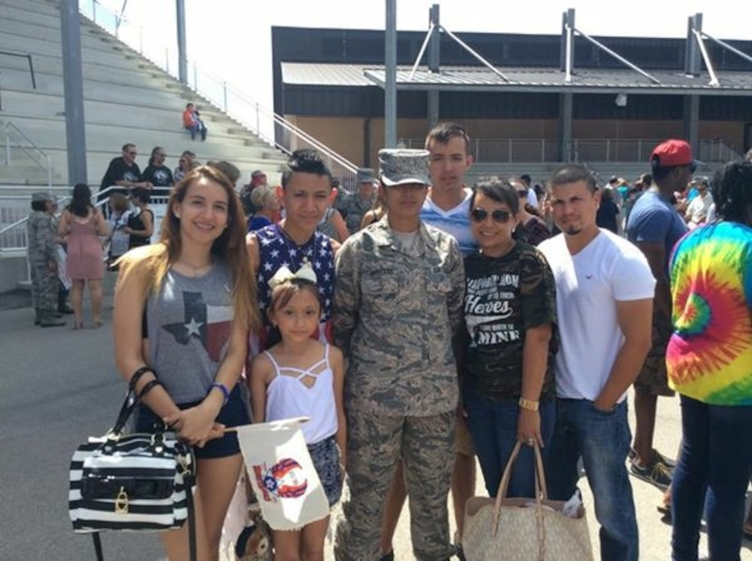 """U.S. Air Force Airman 1st Class Alicia """"Alice"""" Contreras, 7th Bomb Wing paralegal, with her family upon her basic military training graduation July 19, 2015, at Lackland Air Force Base, Texas. Contreras joined the U.S. Air Force with the promise that she would be able to gain U.S. citizenship. After being assigned to Dyess Air Force Base Oct. 15, 2015, she was able to start the process and finally took the oath of citizenship Feb. 7, 2017. (Courtesy photo)"""