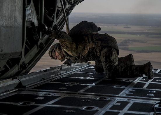 Master Sgt. Ed Dewejko, 19th Operational Support Squadron Survival, Evasion, Resistance and Escape superintendent, performs pre-jump safety checks before a static line jump from a Lockheed C-130 Hercules above the drop zone at Scott Air Force Base, Illinois March 2, 2017. The drop zone is a new addition to the airfield enhancing capabilities to conduct a diverse set of operations. (U.S.Air Force Photo by Airman 1st Class Daniel Garcia)