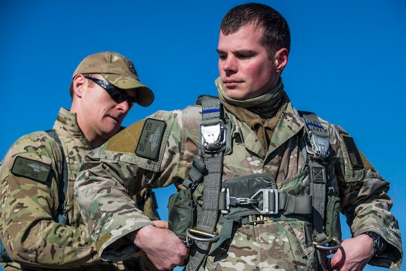 Tech. Sgt. Kyle Oler, 375th Operations Support Squadron's Survival, Evasion, Resistance, and Escape non commissioned officer in charge, helps Staff Sgt. Sam Neitzer, 375th OSS SERE specialist prepare his gear before a static jump on March 2, 2017 at Scott AFB, Illinois. Scott AFB hosted this jump to streamline its capabilities and jump program while offering jumpers an opportunity to get required jumps accomplished as they face weather challenges elsewhere. The 375th OSS created the drop zone to increase the readiness of units in and around Scott AFB and for use by flying or ground units with an interest and the requirements. (U.S. Air Force photos/Senior Airman Tristin English)