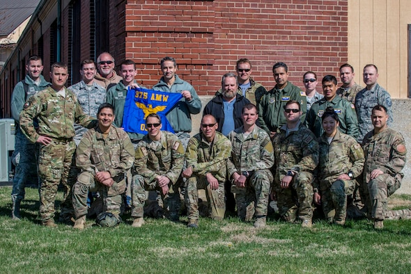 Scott Air Force Base hosted its first ever air drop with members of the 375th Operations Support Squadron's Survival, Evasion, Resistance, and Escape (SERE) unit and members of  the 19th OSS from Little Rock AFB as well as members of the Air National Guard participating in a jump over the drop zone on March 2, 2017 at Scott AFB, Illinois. Scott hosted this jump to streamline its capabilities and jump program while offering jumpers an opportunity to get required jumps accomplished as they face weather challenges elsewhere. The 375th OSS created the drop zone to increase the readiness of units in and around Scott AFB and for use by flying or ground units with an interest and the requirements. (U.S. Air Force photos/Senior Airman Tristin English)