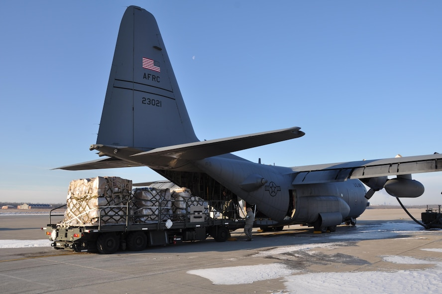 Nearly 6,000 lbs. of donated softball equipment and school supplies from schools and businesses around Western New York is loaded onto a 914th Airlift Wing C-130 aircraft, February 17, 2017, at the Niagara Falls Air Reserve Station, N.Y. The equipment and supplies are bound for the Dominican Republic, where they will be distributed to schools in need. The Air Force is able to transfer the donations through a program called Denton Cargo, which enables humanitarian supplies to be transferred on military aircraft if space available. (U.S. Air Force photo by Master Sgt. Kevin Nichols)