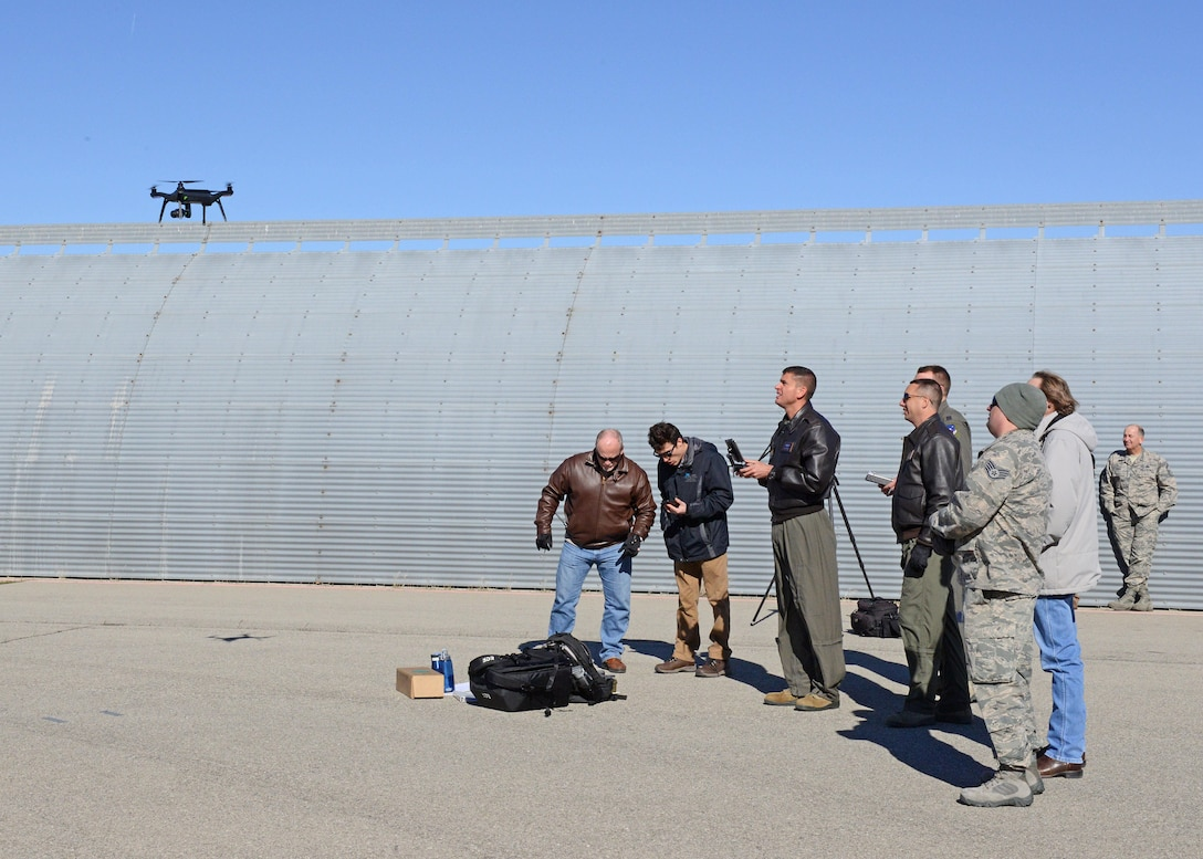 The 412th Test Wing's Emerging Technologies Combined Test Force conducted three test sorties March 6 using a quadcopter to inspect a C-17 Globemaster III. Maj. Dan Riley, ET CTF director, and Maj. William Niblack, ET CTF operations officer, piloted the small unmanned aerial system. (U.S. Air Force photo by Kenji Thuloweit)
