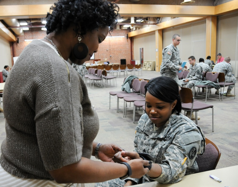 Sgt. 1st Class Miranda Toussaint, a finance instructor with the U.S. Army Reserve's 8th Battalion, 98th Regiment, has her blood pressure checked by Lisa Walls, event oversight administrator with Logistics Health Incorporated, during the 99th Regional Support Command's Soldier Readiness Improvement Event March 4 at the Frank B. Lotts Center in Richmond, Virginia. This event was the first in the 99th RSC's new Soldier Readiness Improvement Initiative, which offers unit commanders a one-stop shop for personnel and medical readiness that helps make Soldiers mission capable.