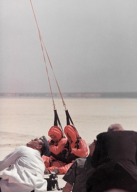 King 52 was one of a few HC-130Hs converted to conduct rescue operations in the 1960s. Pictured above is tail# 14859 conducting a Fulton Surface-To-Air Recovery System test in May 1966. The kit is dropped to a person in the water who puts on a red balloon suit with harness and is reeled aboard the plane. Recovery kits were designed for one- and two-man recoveries. (Edwards History Office photo)